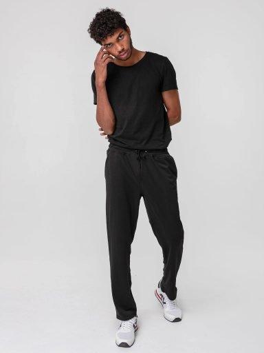 Czarne spodnie z kieszeniami Love & Live