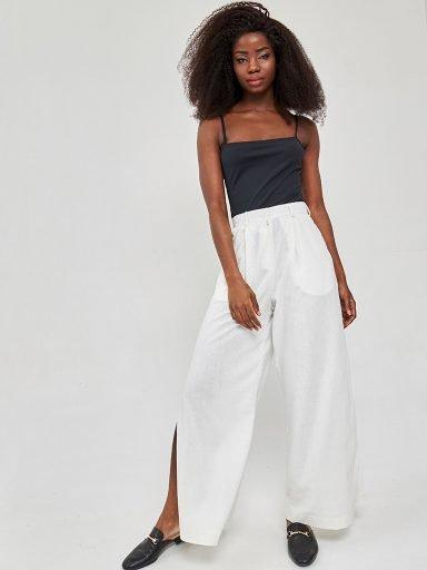 Szerokie spodnie lniane w kolorze mlecznym Katarina Ivanenko