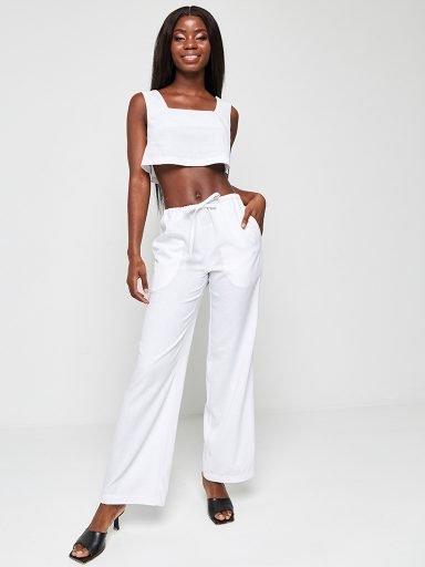 Lniane spodnie w kolorze bieli Katarina Ivanenko