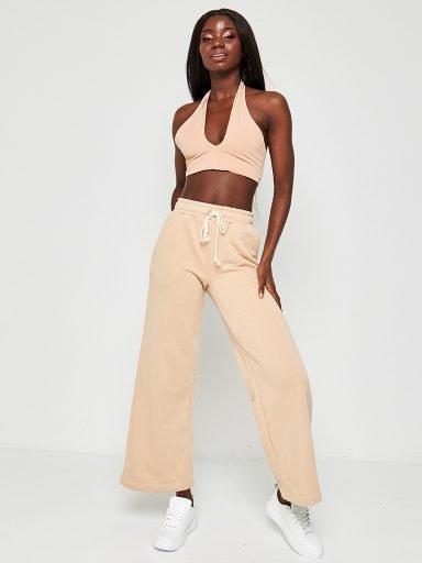 Sportowe spodnie oversize skrócone pudrowe Katarina Ivanenko